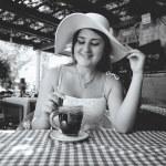 Monochrome portrait of cute woman having breakfast with tea — Stock Photo #58980973