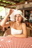 Portrait of beautiful woman in restaurant looking with amazement — Stock Photo