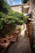 Restaurant summer terrace on ancient street — Stock Photo