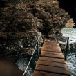 View from inside of the sea cave with wooden path — Stock Photo #59464629