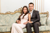 Couple in love hugging on luxurious sofa  — ストック写真