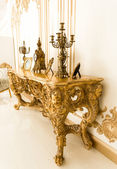 Classic golden table in with old chandeliers — Stock Photo
