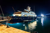 Luxurious private yacht moored at night port — Stock Photo