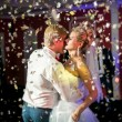 Portrait of confetti flying at dancing beautiful bride and groom — Foto Stock #59667825