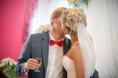 Portrait of bride and groom kissing at restaurant — Stock Photo