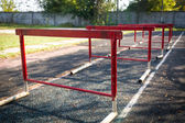 Old red hurdles for a hurdle race on abandoned stadium — Stock Photo