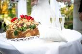 Traditional orthodox wedding bread lying on ceremonial table — Stock Photo