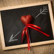 Drawn on chalkboard arrow going through decorative heart — Stock Photo #62575193