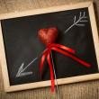 Drawn on chalkboard arrow going through decorative heart — Stock Photo #62575193
