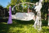 Beautiful decorated for wedding swing at backyard — Stock Photo
