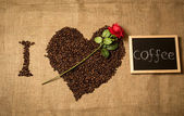 "Conceptual shot of ""I love coffee"" spelled by coffee beans, chal — Stock Photo"