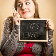 Thoughtful woman holding blackboard with yes and no options — Stock Photo #62639129