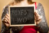 """Young woman holding blackboard with checked """"yes"""" box — Stock Photo"""