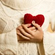 Woman holding red heart at chest — Stock Photo #62640241