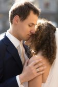 Portrait of handsome caring groom hugging cute bride — Stock Photo