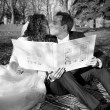 Monochrome portrait of just married couple holding photo album — Stock Photo #62830361