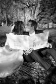 Monochrome portrait of just married couple holding photo album  — Stock Photo