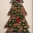 Decorative Christmas tree on building wall — Stock Photo #64412667