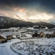Beautiful view of sunset over the village in Austrian Alps — Stock Photo #64413467