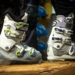 Pair of new ski boots on wooden board — Stock Photo #64413919