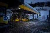 Ski lifts at night on high snowy mountain at Austrian Alps — Stock Photo