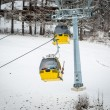 Yellow cable cars on ski slope at Austrian Alps — Stock Photo #64644711