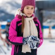 Smiling girl posing on top mountain covered by snow — Stock Photo #64645143