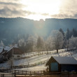 Sunset over highland Alpine village covered by snow — Stock Photo #64646077