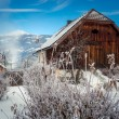 Old wooden barn in Austrian Alps covered by snow — Stock Photo #64646103