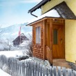 Wooden porch covered by snow in Austrian Alps — Stock Photo #64646115