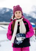 Cute girl playing in snowballs on top of high mountain — Stock Photo