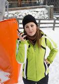 Young woman talking on radio at ski slope — Stock Photo