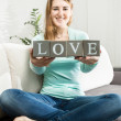 "Conceptual photo of woman holding word ""love"" made of bricks — Stock Photo #66423255"