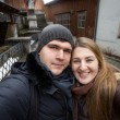 Smiling couple making selfie on street at winter day — Stock Photo #66668535