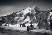 Black and white landscape of high mountains covered by snow — Stock Photo