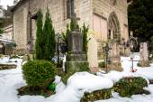 Cemetery covered by snow at old churchyard  — Stock Photo