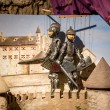 Closeup of puppet theater with two knights standing on tower — Stock Photo #66682875