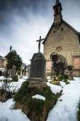 Graveyard at churchyard covered by snow — Stock Photo