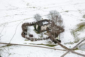 Aerial view on lonely house in field covered by snow at Salzburg — Stock Photo