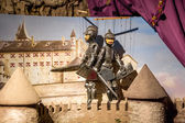 Closeup of puppet theater with two knights standing on tower — Stock Photo