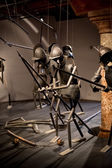 Ancient battle reconstruction with armors in museum — Stock Photo