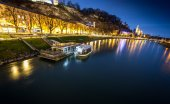Excursion boat moored on river at night at Salzburg — Stock Photo
