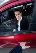 Burglar breaking into the car. Scared woman blocking the door — Stock Photo