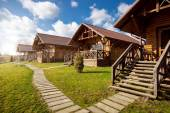 Wooden cottages at sunny day in the countryside — Stock Photo