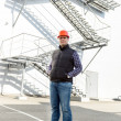 Confident male worker posing against factory — Stock Photo #70090967