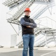 Architect posing against metal construction — Stock Photo #70091033