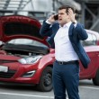 Angry man talking by phone because of broke down car — Stock Photo #70220003