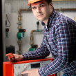 Young engineer adjusting system work on control panel — Stock Photo #71711063
