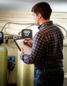 Portrait of male engineer checking condition of factory equipmen — Stock Photo