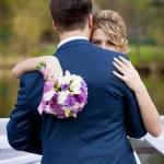 Closeup of elegant blonde bride looking over grooms shoulder — Stock Photo #72283163